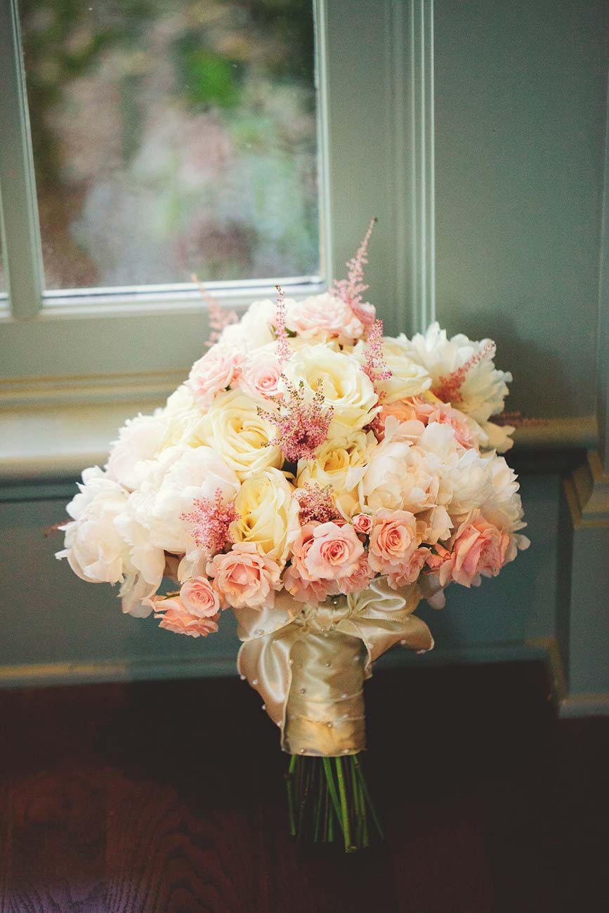 Bridal bouquet propped up against a wall