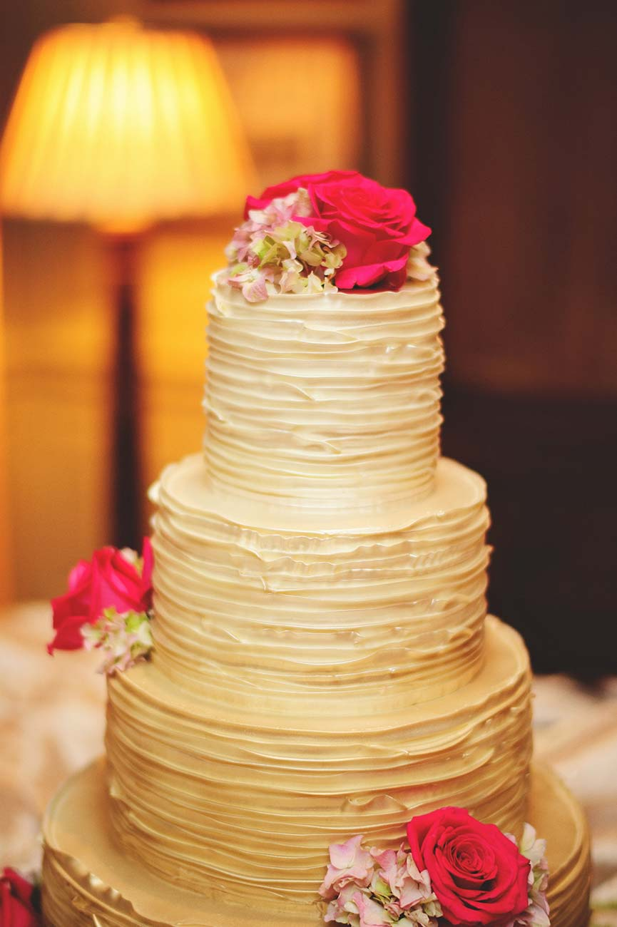 4 tiered wedding cake with roses