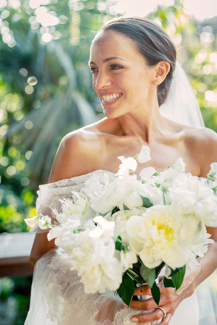 Portrait of bride smiling and holding her wedding bouquet