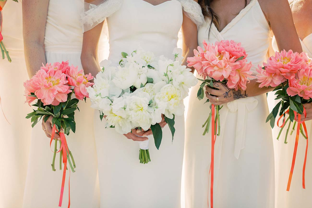 Close up of bride and bridesmaid's bouquets being held