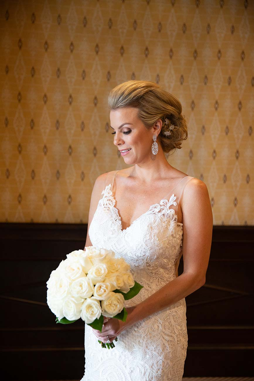 Portrait of bride holding her white bouquet