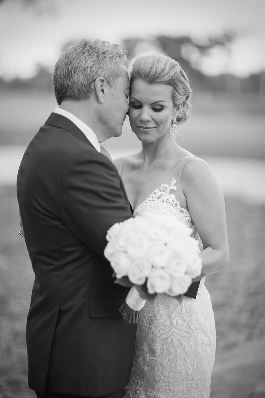 Portrait of bride and groom in an embrace