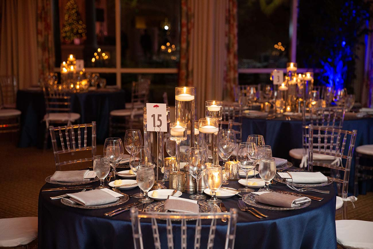 Table top design of crystal and candles at wedding reception
