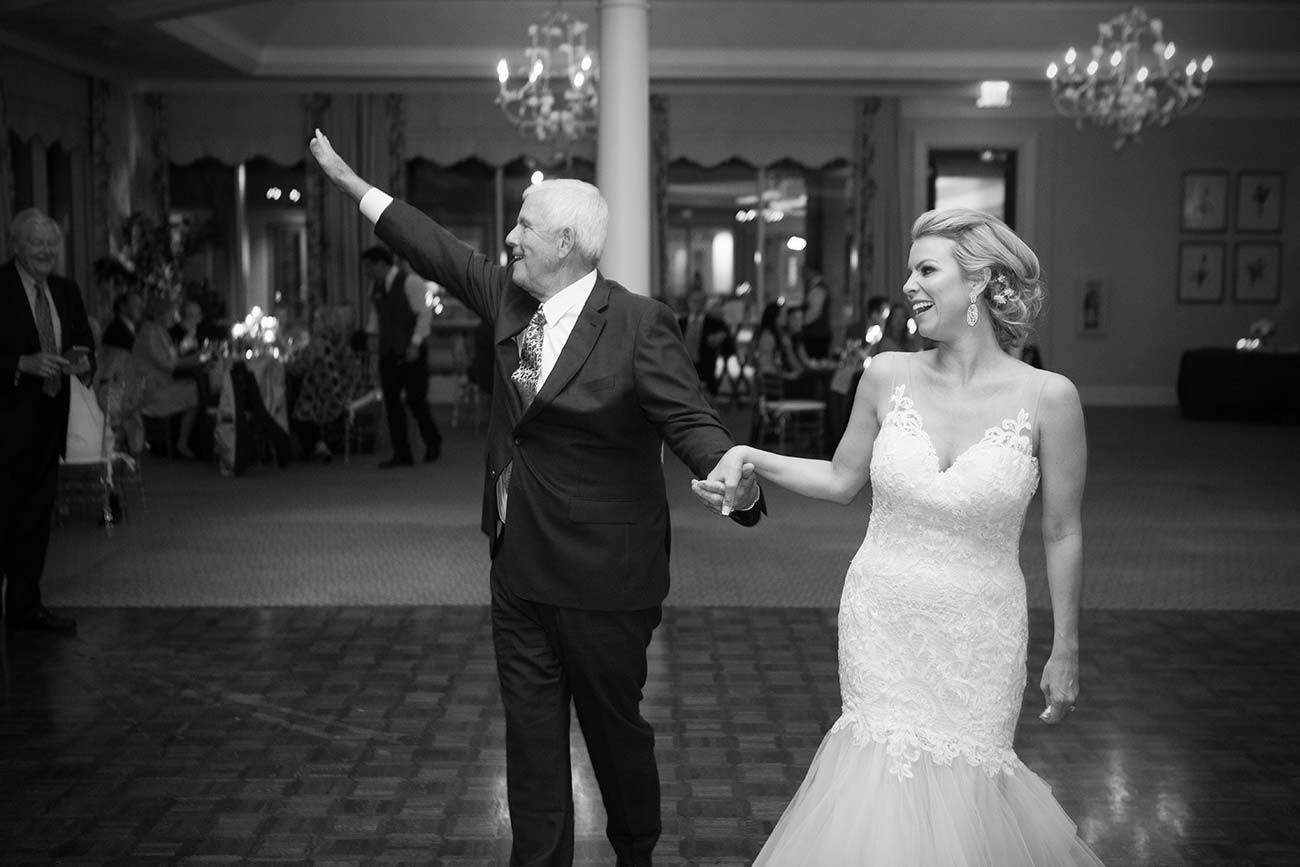 Bride & groom waving at guests