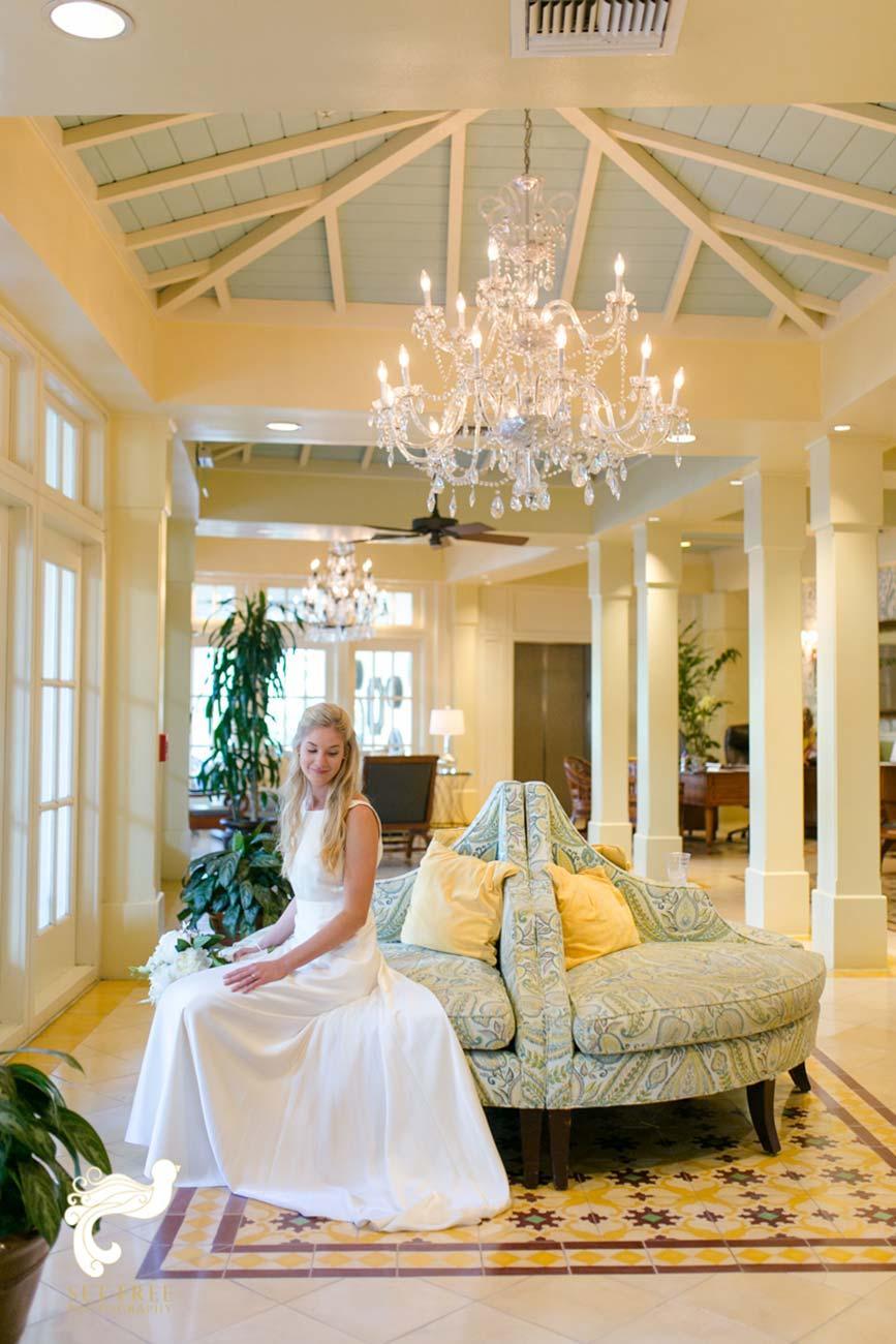 Bride sitting on chair inside lobby