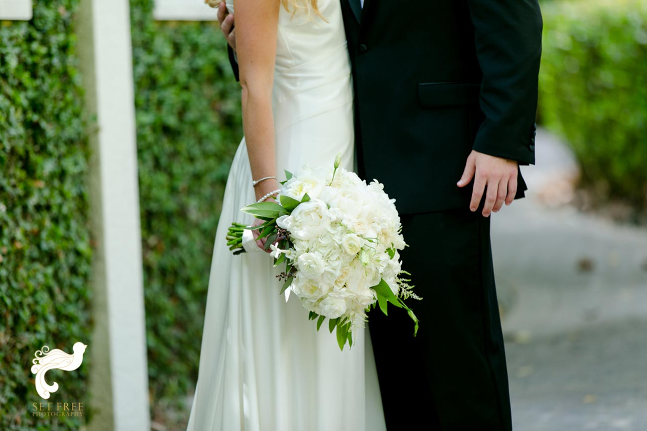 Close up of bride and groom with bride's bouquet showing