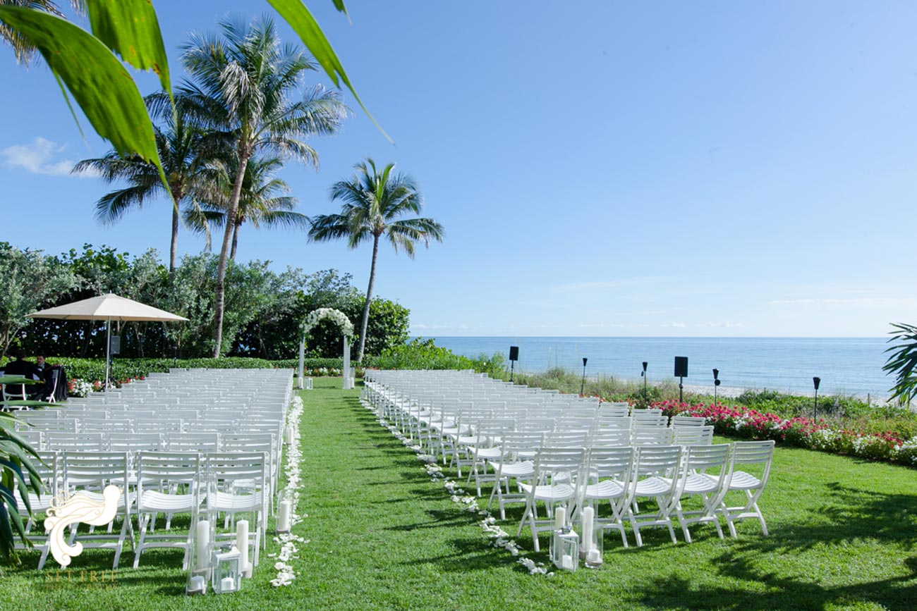 Ceremony set up on lawn overlooking beach