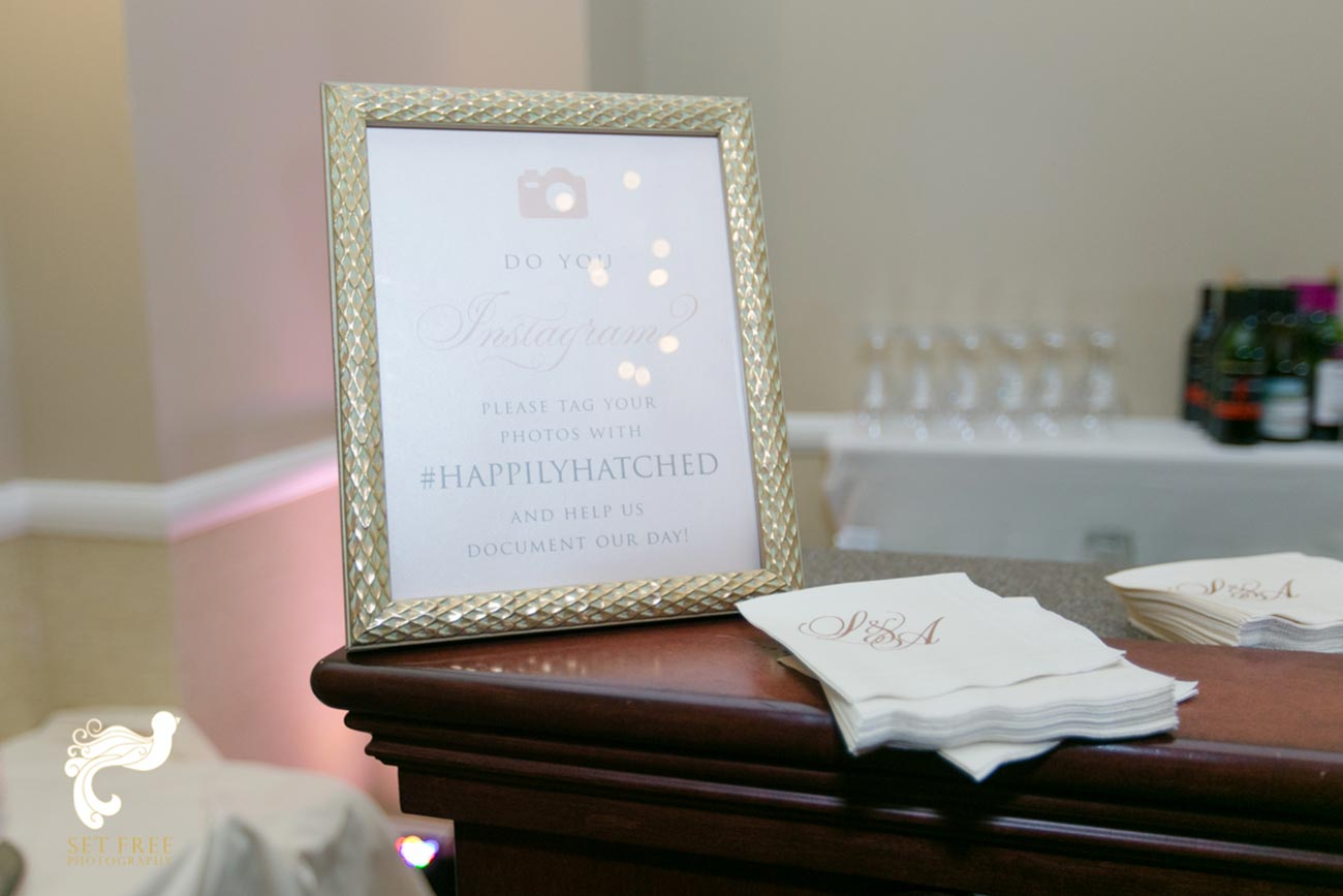 Frame with typed instructions for a photo booth, sitting on top of a desk