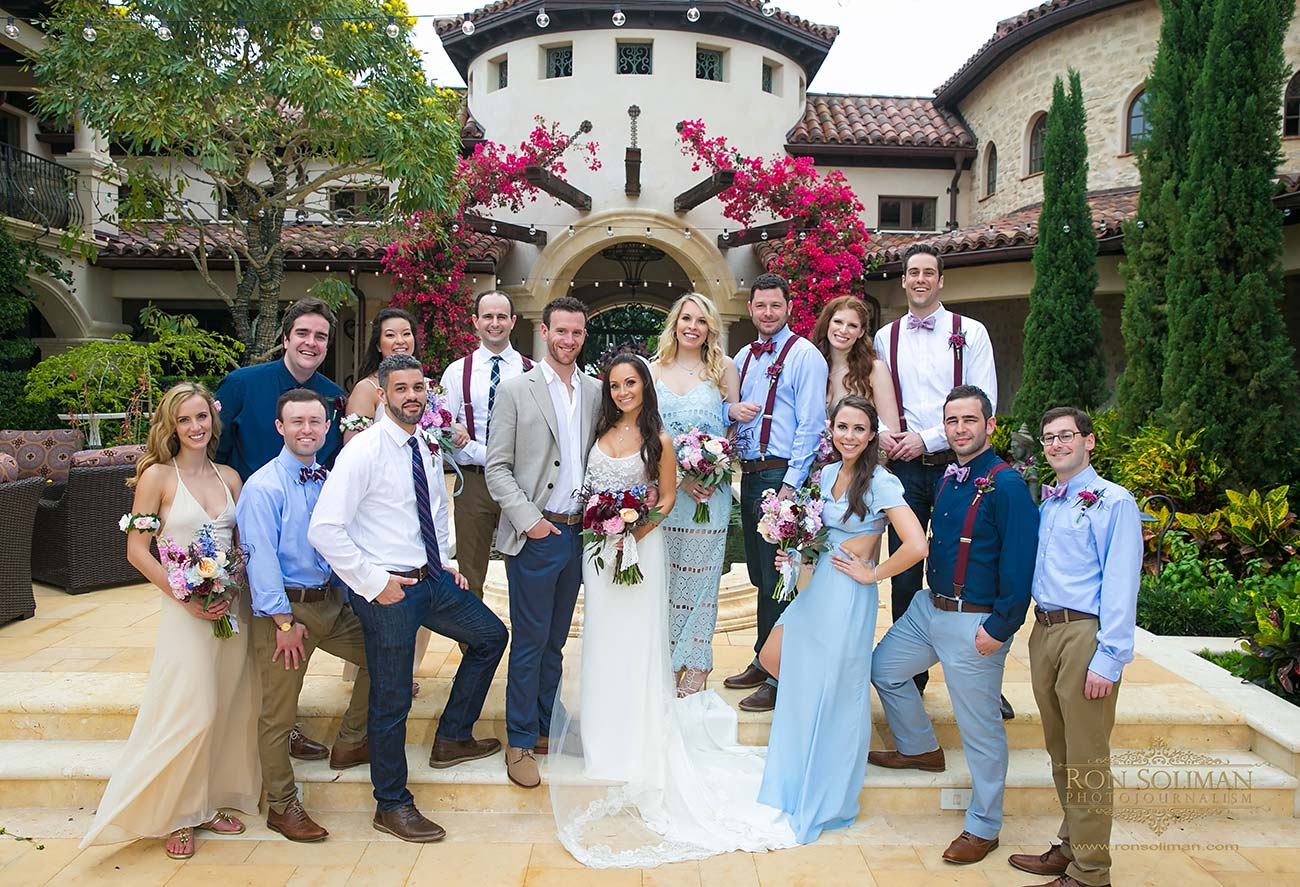 Formal bride and groom and wedding party portrait in front of wedding venue