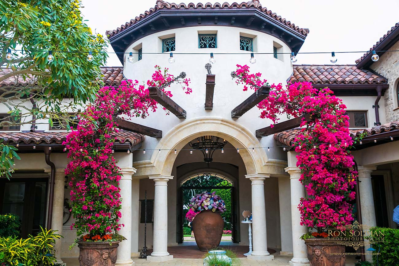 Entrance of wedding reception location surrounded by bougainvilleas