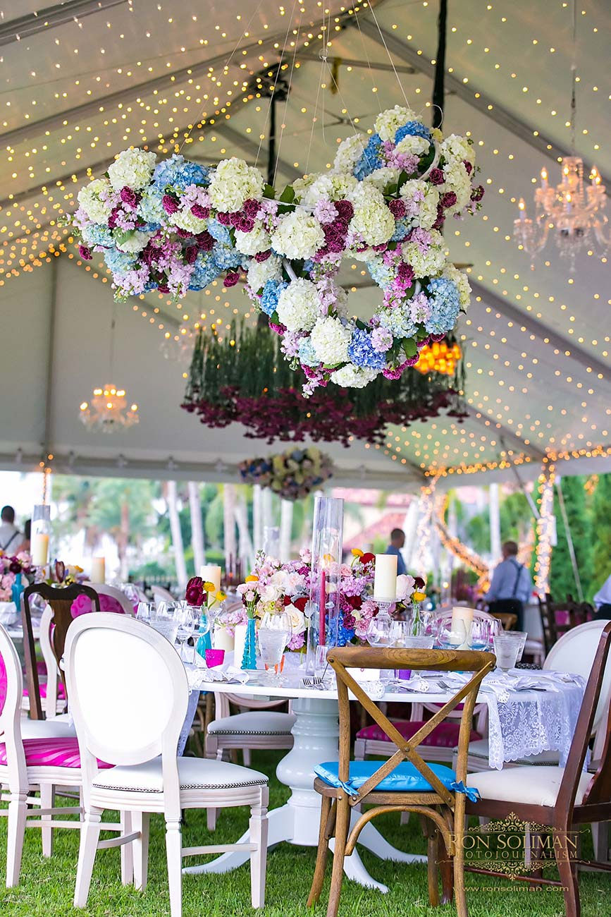 Hanging florals, table top wedding reception design inside a white wedding tent