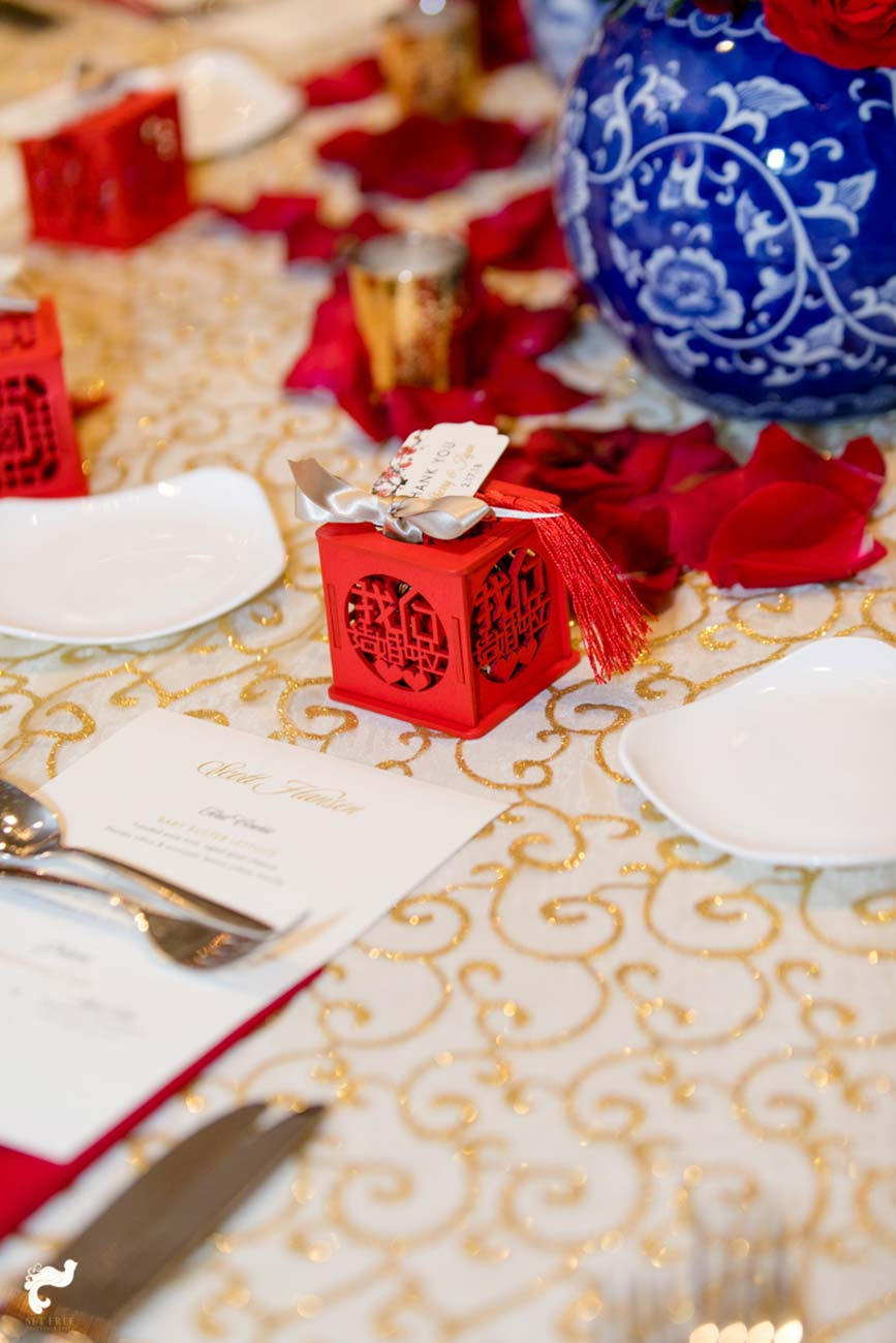 Wedding reception table top design with red, blue and white accents