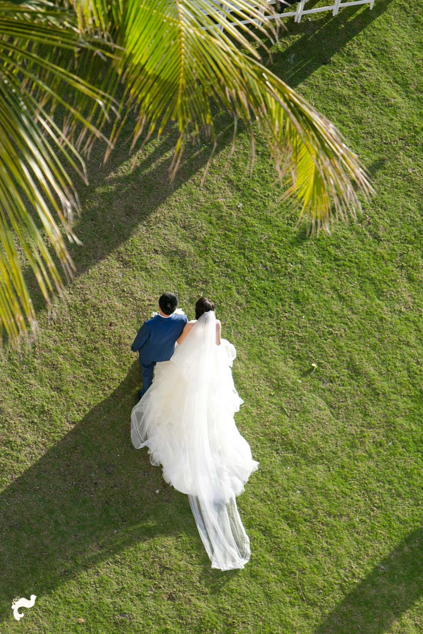 View of the bride and groom walking on a golf course, photographed from high above