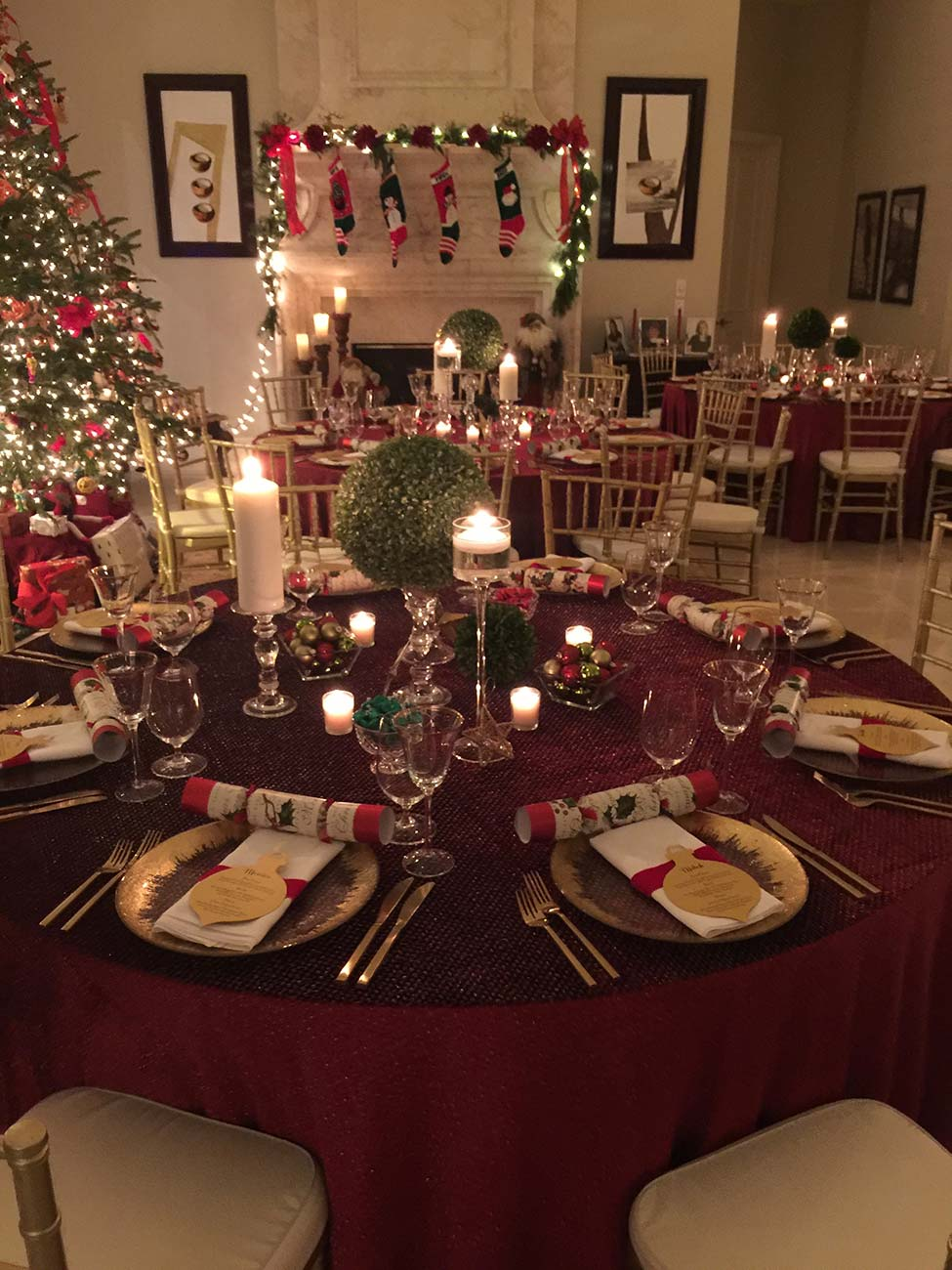 Tabletop Christmas dinner design with silverware, dinnerware and a Christmas tree in the background