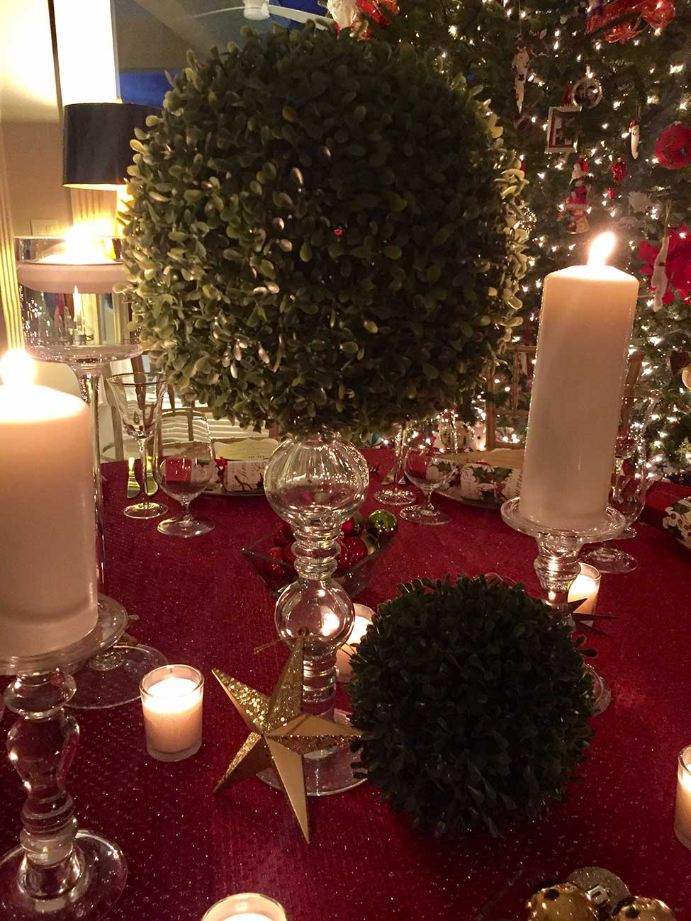 Close up of centerpiece in Christmas inspired table top design