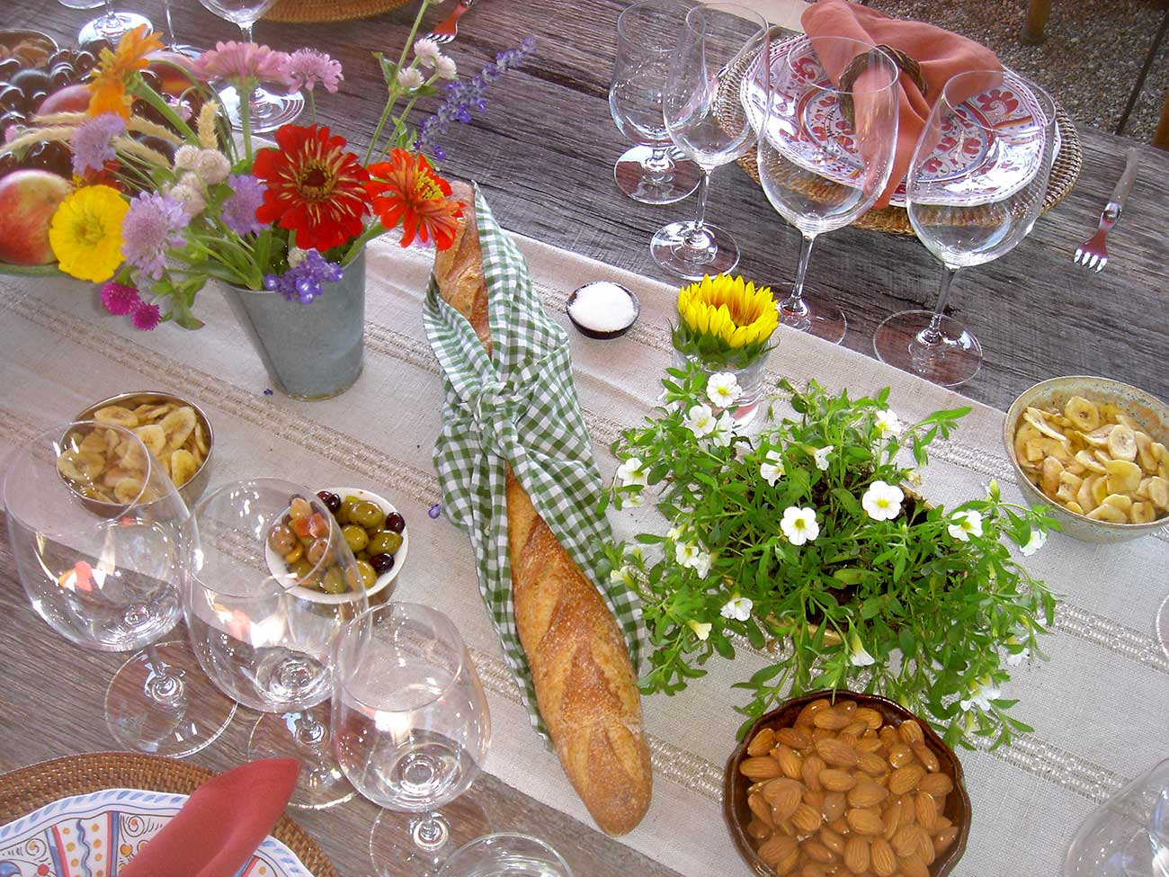 Tabletop design with bread, wild flowers and crystal