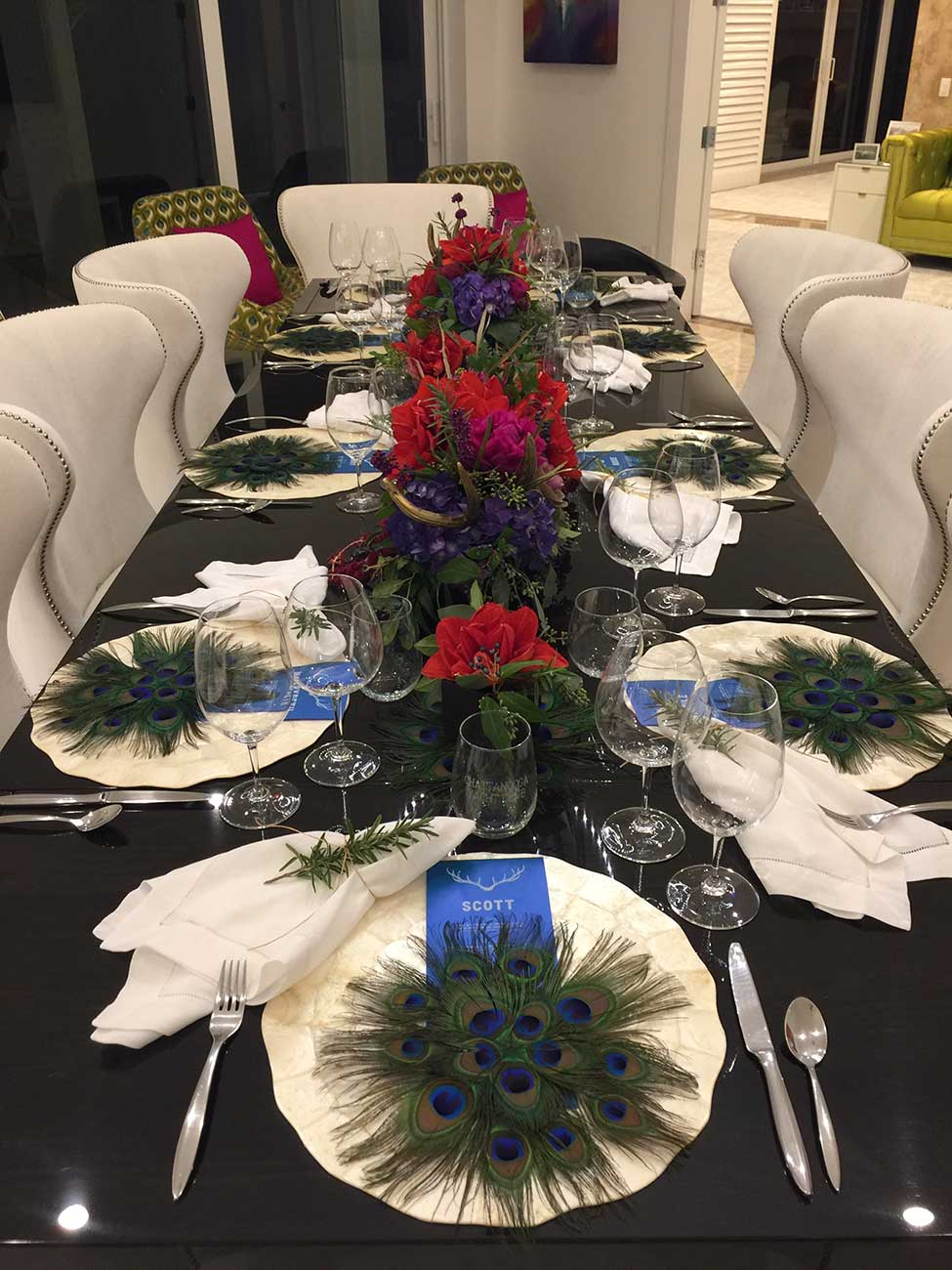Naples Wine Festival donation dinner tabletop design with peacock feather designs including tableware and menu cards