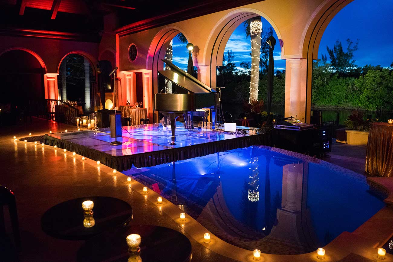 View of piano and uplighting overlooking bay