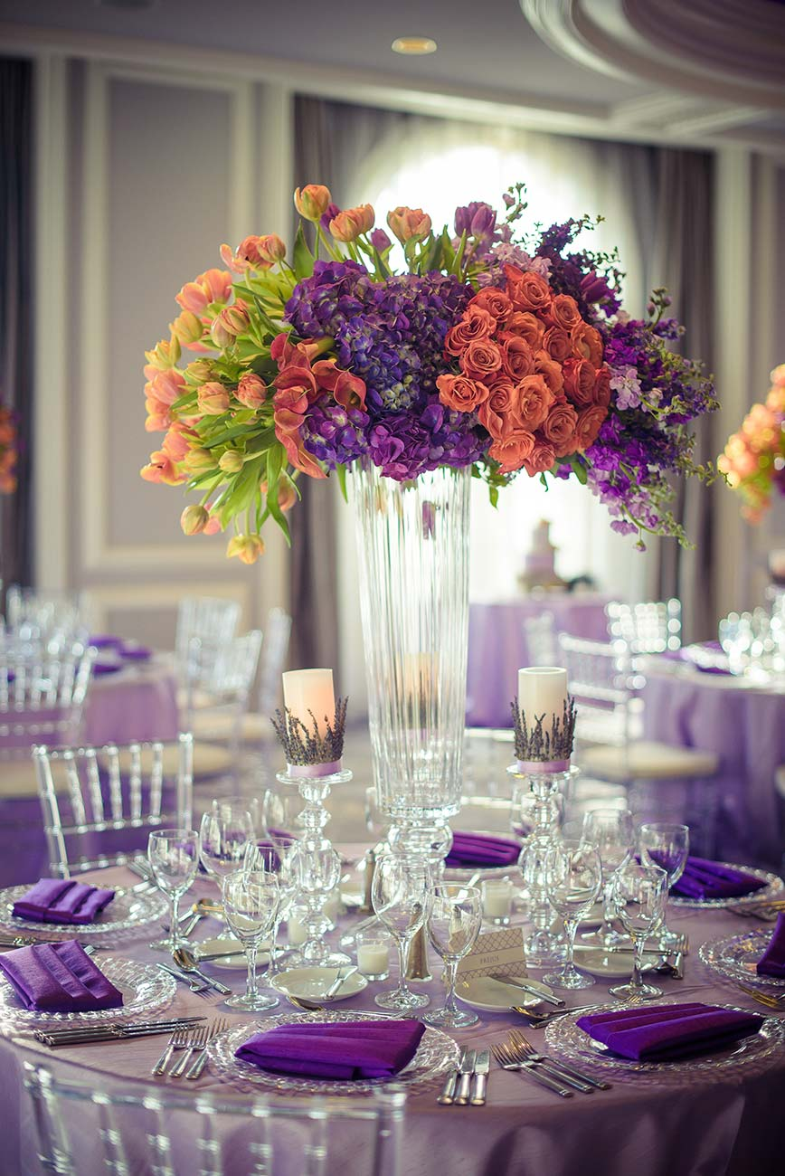 Reception room with tabletop designed linens, crystal, florals and dinnerware