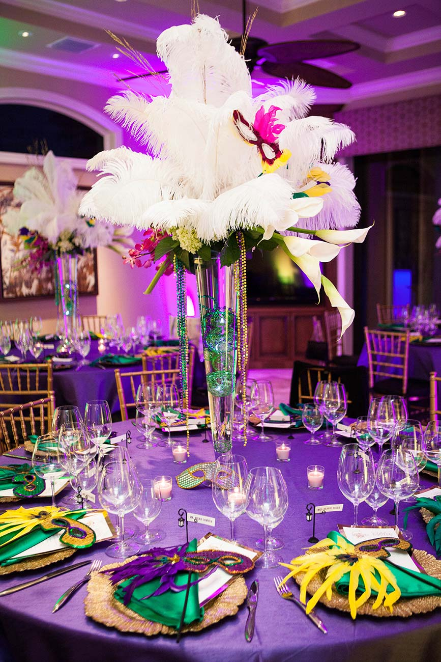 Wine dinner tabletop design in traditional Mardi Gras colors showing crystal and dinnerware
