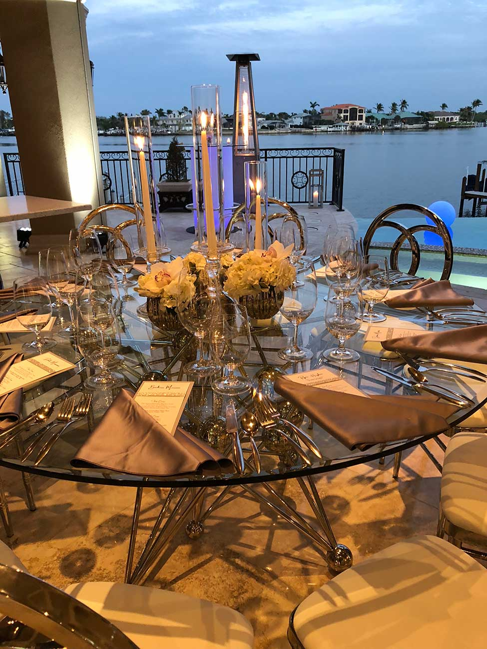 Tabletop design set on a round glass table overlooking a bay